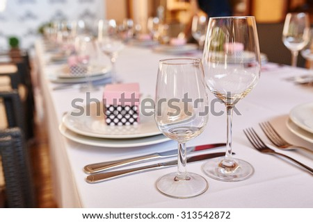 beautifully decorated table in the restaurant for the wedding dinner