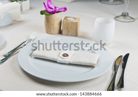 Beautifully decorated table in the restaurant. Linen tablecloth and napkin - stock photo