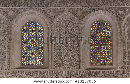 Beautifully decorated wall with windows in madrasa  Bou Inania in Fez, Morocco