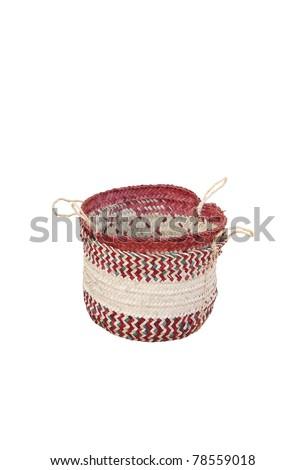 Beautifully designed date palm leaves basket isolated on white - stock photo