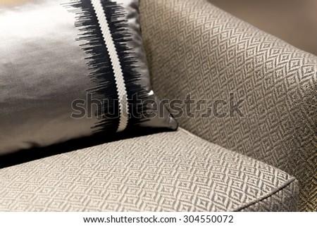 Beautifully Elegant Chair with Stylish Patterned Cushion - stock photo