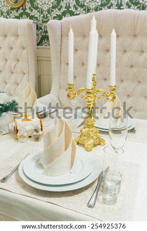 Beautifully organized event - served banquet table ready for guest closeup - stock photo