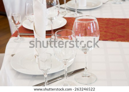 Beautifully organized event - served festive round table close-up in luxurious interior - stock photo