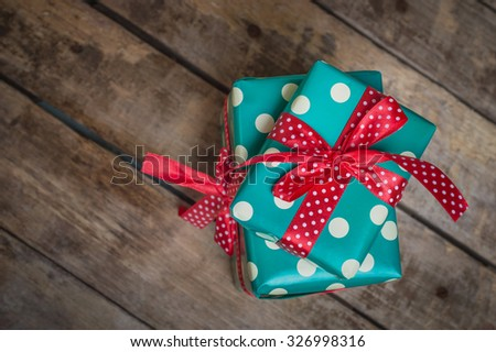 beautifully packaged gifts on wooden table - stock photo