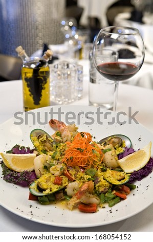 Beautifully plated seafood medley consisting of mussels, scallops and shrimp. - stock photo