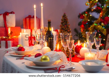 Beautifully set table for Christmas Eve - stock photo
