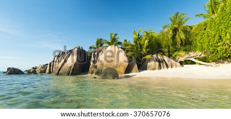 Beautifully shaped granite boulders and a perfect white sand at the famous Anse Source d'Argent beach, La Digue island, Seychelles. Panorama - stock photo