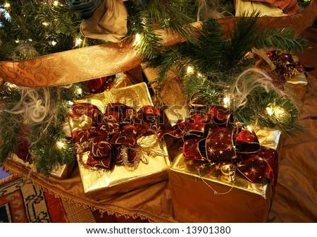 beautifully wrapped xmas presents under xmas tree - stock photo