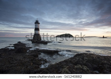 beautuful lighthouse at penmon point, anglesey at sunrise