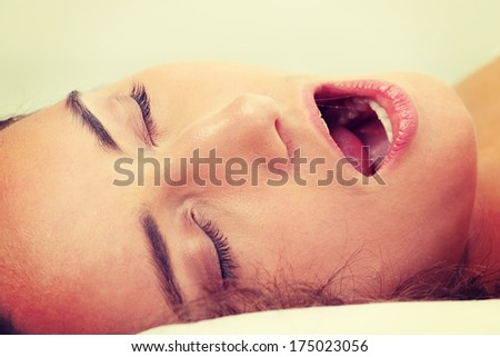 Beauty adult caucasian woman in bed - stock photo