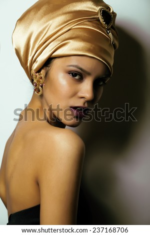 beauty african woman in shawl on head, very elegant look with gold jewelry  - stock photo