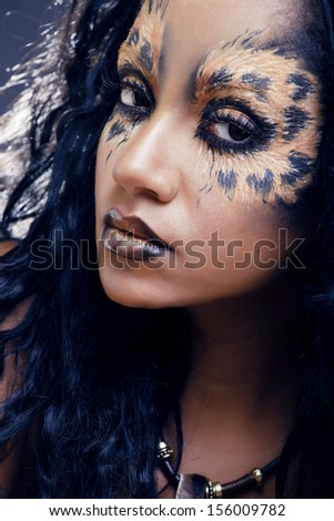 beauty afro girl with cat make up, creative leopard print - stock photo