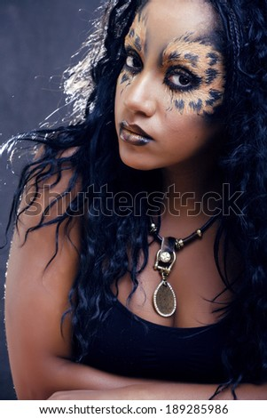 beauty afro girl with cat make up, creative leopard print