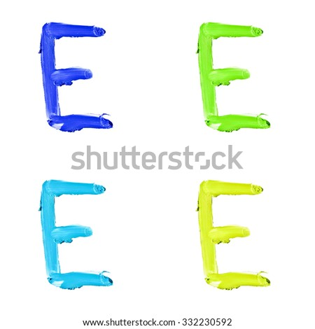 """Beauty alphabet set - blue, green and yellow dye letters isolated on white background. """"E"""" letter. - stock photo"""