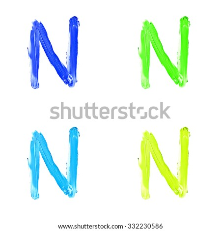"""Beauty alphabet set - blue, green and yellow dye letters isolated on white background. """"N"""" letter. - stock photo"""
