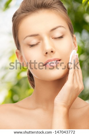 beauty and eco cosmetology concept - beautiful woman with cotton pad - stock photo