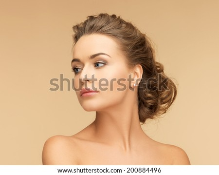beauty and jewelery concept - beautiful woman with pearl earrings - stock photo