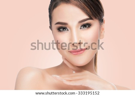Beauty Asian portrait of beautiful cheerful young fresh woman. Youth and Skin Care. Beauty Model Female looking at camera.Concept. on pink background with clipping path. - stock photo