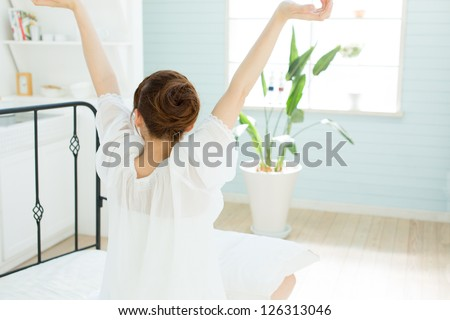 Beauty asian woman relaxing in the bed room - stock photo