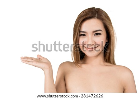 Beauty Asian woman showing product on side with open hand, empty copy space on open hand palm - stock photo