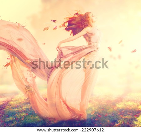 Beauty Autumn Woman, beautiful fantasy girl, fairy in blowing transparent chiffon dress. Fall. Fashion model lady in windy autumn park - stock photo