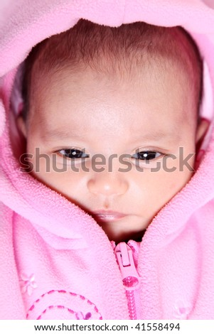 Beauty Baby face with pink hood. Open eyes - stock photo