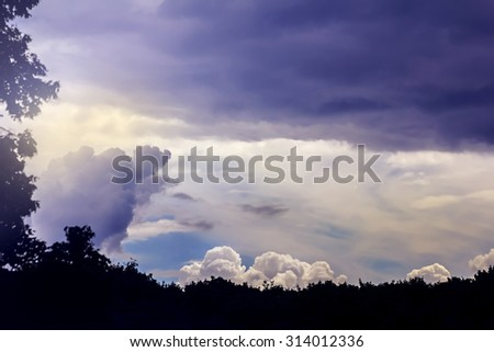 Beauty big white clouds in blue sky and rays of sun - stock photo
