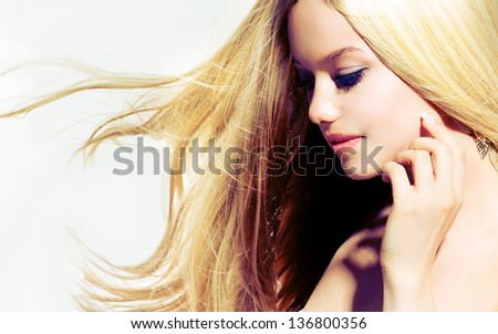 Beauty Blond Girl With Long Healthy Blowing Hair. Hair Extensions - stock photo