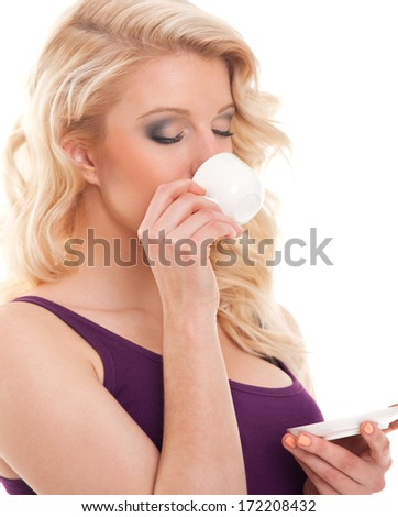 Beauty blond hair girl drinking coffee from small cup. White background. - stock photo