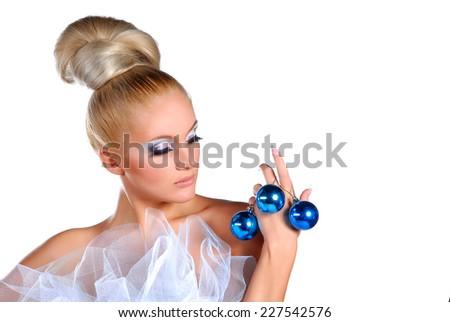 Beauty blond holding christmas balls - stock photo