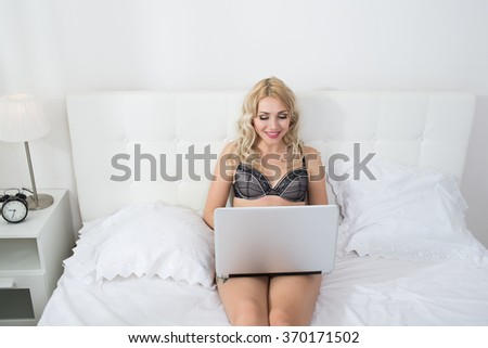 Beauty blonde woman in white bed - stock photo