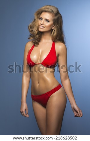 Beauty blonde woman like lifeguard - stock photo