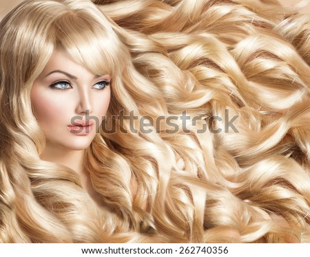 Beauty Blonde Woman Portrait. Beautiful model girl with long curly blond hair. Hairdressing, hairstyle. Healthy Long Wavy Hair. White Hair. Sexy Model. Perfect Skin and Make up. Hair Extensions  - stock photo
