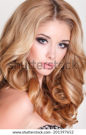 Beauty blonde woman with gorgeous long hair, young fashion girl portrait, vogue style luxury woman bright makeup and curly hairstyle. isolated, studio. series - stock photo
