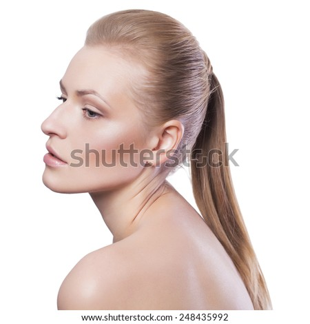 Beauty. Blonde woman with ponytail. Fresh clean skin, neutral make up. Isolated on white