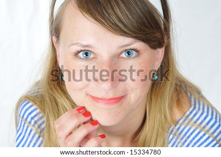 beauty blue-eyed girl sincerely look at camera - stock photo