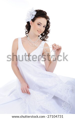Beauty bride in white wedding dress with curly hairs - stock photo