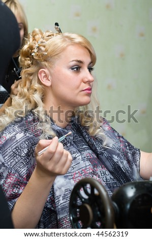 Beauty bride the blond. Bride prepares to the wedding ceremony in room. Portrait. Caucasian