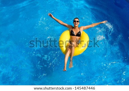 Beauty Brunette at Water Park - stock photo