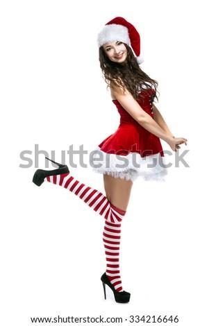 beauty brunette girl in santa hat on white background - stock photo