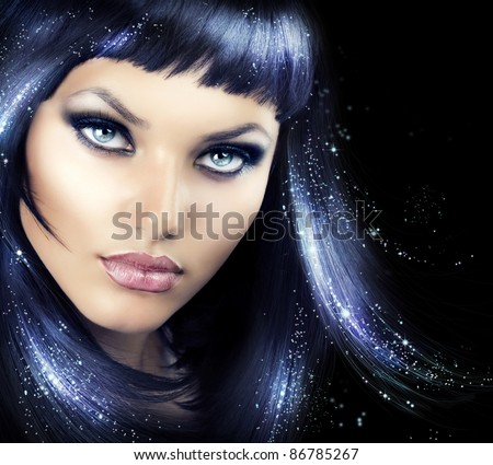Beauty Brunette Girl with Magic Hair - stock photo