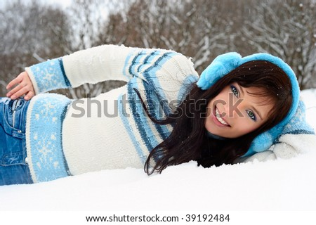Beauty brunette on the snow. - stock photo