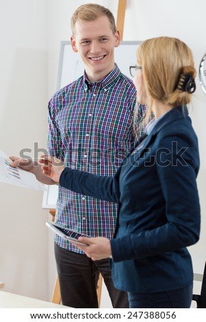 Beauty businesswoman giving advise her young coworker - stock photo