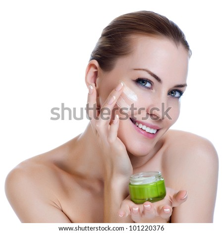 Beauty caucasian young woman applying cosmetic under eyes - stock photo