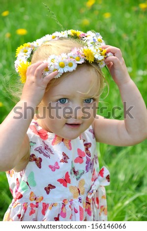beauty child in wreath at summer - stock photo