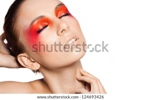 Beauty close-up female portrait .  Model face with magic creative fashion multicolored make-up. Perfect skin. Face painting, cosmetics, beauty and make up. White background.Space.Orandge eyeshadow. - stock photo