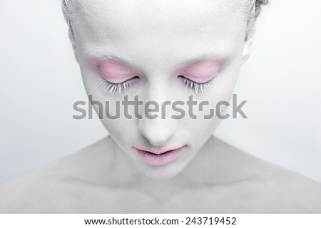 beauty closeup portrait of white painted face art with pink eyes and lips  - stock photo
