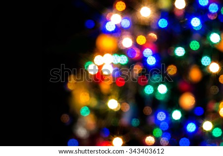 Beauty color blurred christmas and happy new year lights at night (Space for greeting text) - stock photo