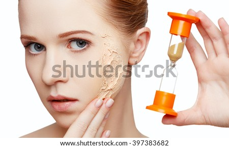 beauty concept rejuvenation, renewal, skincare and skin problems with hourglass - stock photo