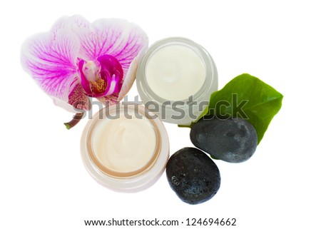 Beauty creams  with orchid and spa stones